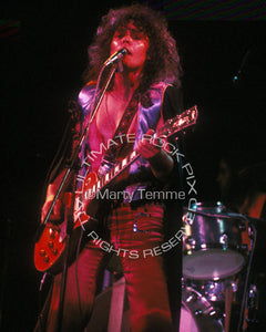 Photo of Marc Bolan of T. Rex playing a Les Paul in concert