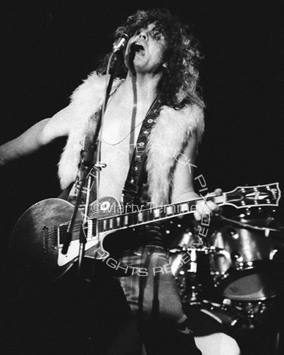 Black and white photo of Marc Bolan of T. Rex playing a Les Paul in 1973 by Marty Temme