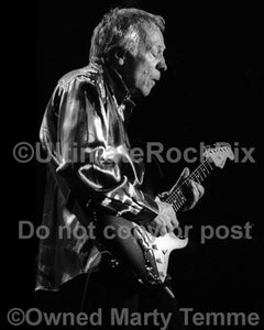 Black and white photo of Robin Trower performing in concert in 1999 by Marty Temme