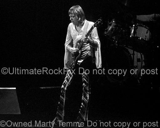 Black and white photo of Robin Trower playing a Gibson SG in concert in 1977 by Marty Temme