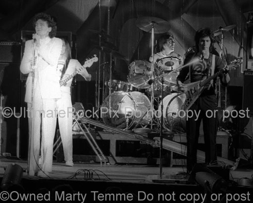 Photo of Fee Waybill, Bill Spooner and Prairie Prince of The Tubes in concert in 1975 by Marty Temme