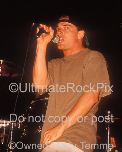 Photo of Whitfield Crane of Ugly Kid Joe in concert in 1992 by Marty Temme