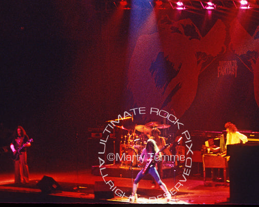 Photo of Mick Box, Ken Hensley, Lee Kerslake and David Byron of Uriah Heep in 1976 by Marty Temme