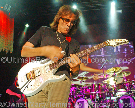 Photo of guitarist Steve Vai in concert in 2009 by Marty Temme