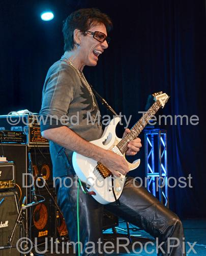 Photos of Guitar Player Steve Vai Performing Onstage in 2012 by Marty Temme