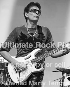 Black and white photo of guitarist Steve Vai in concert in 2012 by Marty Temme