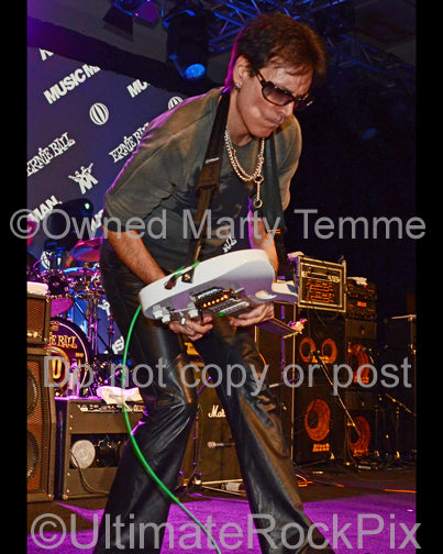 Photo of guitar player Steve Vai performing onstage in 2012 by Marty Temme