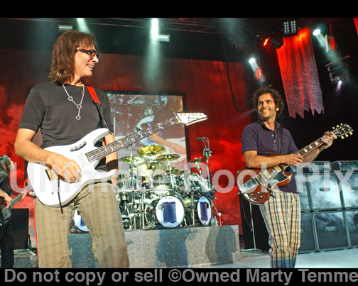 Photo of guitar players Dweezil Zappa and Steve Vai onstage in 2009 by Marty Temme