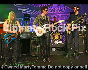 Photo of Steve Morse, Steve Vai and Paul Gilbert performing together in concert in 2012 in Anaheim, California by Marty Temme