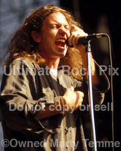 Photo of Eddie Vedder of Pearl Jam in concert in 1992 by Marty Temme