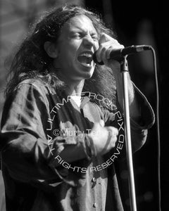 Black and white photo of Eddie Vedder of Pearl Jam in concert in 1992 by Marty Temme