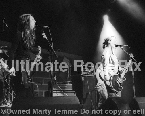 Photo of Nina Gordon and Louise Post of Veruca Salt in concert in 1994 by Marty Temme