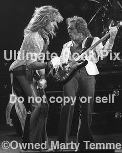 Photo of David Lee Roth and Mike Anthony of Van Halen in concert in 1979 by Marty Temme