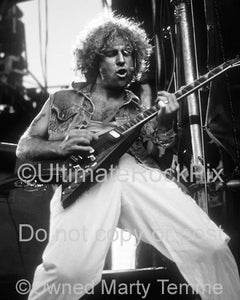 Black and white photo of Sammy Hagar of Van Halen playing guitar in concert in 1986 by Marty Temme