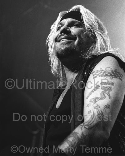 Black and white photo of Vince Neil of Motley Crue in concert by Marty Temme