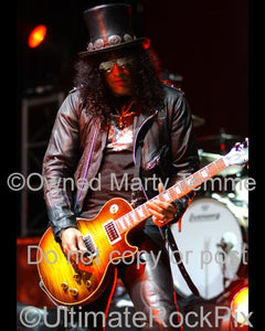 Photos of Slash of Velvet Revolver and Guns N' Roses Playing a Gibson Les Paul in Concert by Marty Temme