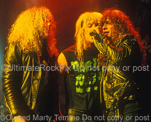 Photo of Jamie St. James, Jani Lane and Paul Shortino together onstage in 1989 by Marty Temme