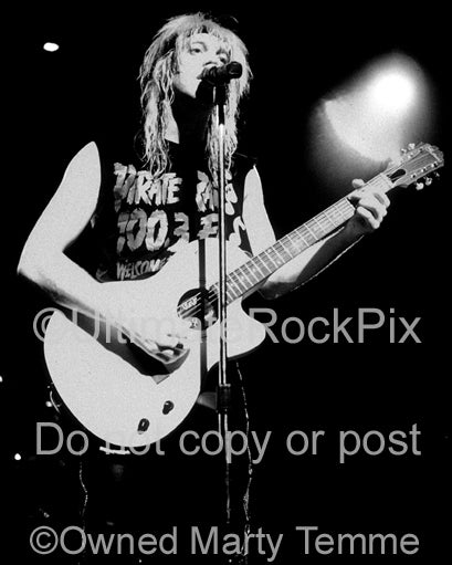 Black and white photo of Jani Lane of Warrant in concert in 1989 by Marty Temme