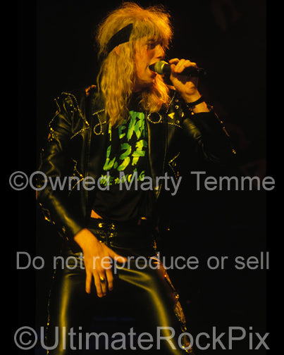 Photo of Jani Lane of Warrant performing in concert in 1989 by Marty Temme