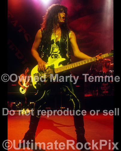 Photo of Jerry Dixon of Warrant in concert in 1989 by Marty Temme