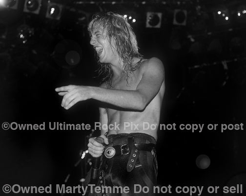Black and white photo of Jani Lane of Warrant in concert in 1988 by Marty Temme
