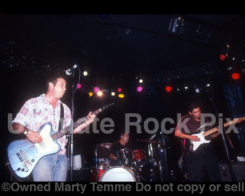 Photo of Mike Watt, Stephen Hodges and Joe Baiza in concert in 1997 by Marty Temme