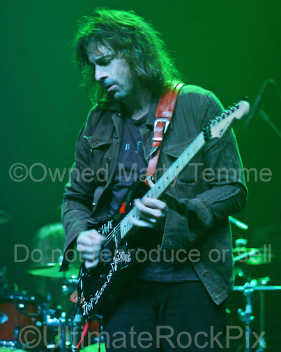 Photo of guitarist Warren DeMartini of Ratt in concert in 2008 by Marty Temme