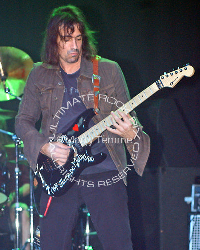 Photo of guitar player Warren DeMartini of Ratt in concert by Marty Temme