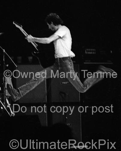 Photos of Pete Townshend of The Who Jumping Through the Air Onstage in Concert in 1980 by Marty Temme