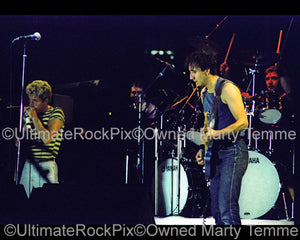 Photo of Pete Townshend, Roger Daltrey and Kenny Jones of The Who in concert in 1982 by Marty Temme