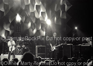 Photo of Pete Townshend, Roger Daltrey, Zak Starkey and John Rabbit Bundrick of The Who in concert in 2000 by Marty Temme