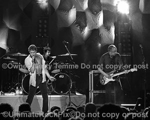 Black and white photo of Pete Townshend and Roger Daltrey of The Who in concert in 2000