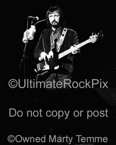 Photo of John Entwistle of The Who in concert in 1974 by Marty Temme