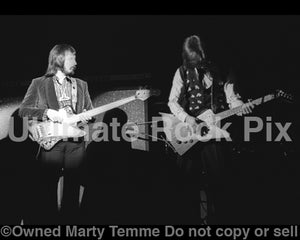Photo of John Entwistle of The Who and Robert A. Johnson in concert in 1974 - whojohnjm74bw21