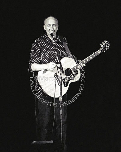 Photo of Pete Townshend of The Who playing a Gibson acoustic guitar in concert by Marty Temme