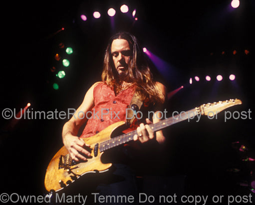 Photo of guitarist Reb Beach of Whitesnake in concert by Marty Temme