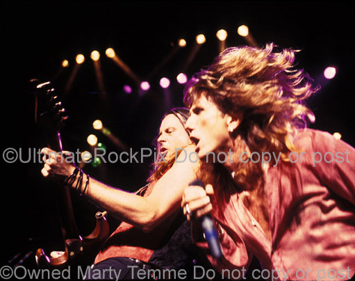 Photo of David Coverdale and Reb Beach of Whitesnake in concert by Marty Temme