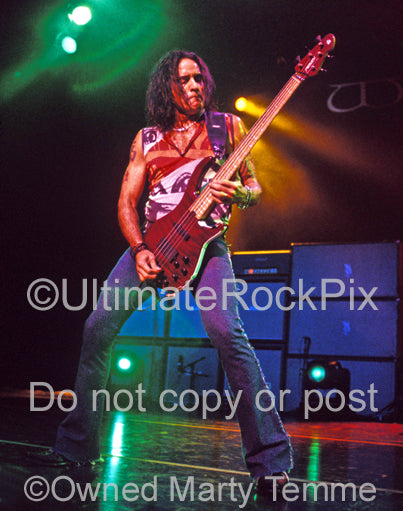 Photo of bassist Marco Mendoza of Whitesnake in concert by Marty Temme