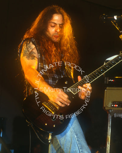 Photo of guitarist Al Pitrelli in concert in 1994 by Marty Temme