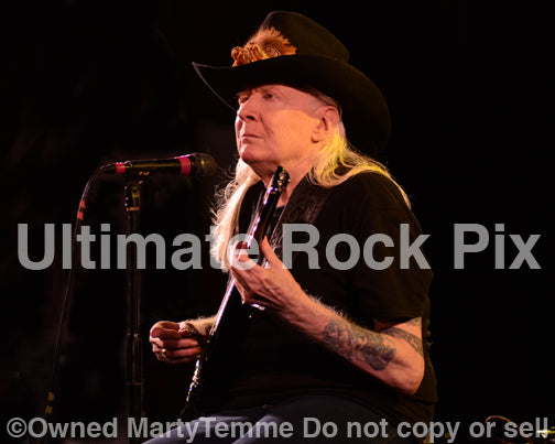 Photo of Johnny Winter in concert in 2013 by Marty Temme