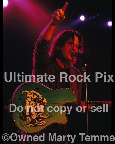 Photo of Kip Winger playing acoustic guitar in 2005 by Marty Temme