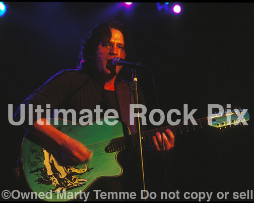Photo of Kip Winger playing an acoustic 12 string guitar in 2005 by Marty Temme