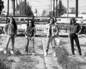 Black and white photo of Kip Winger and the band Winger on a photo shoot in 1993 by Marty Temme