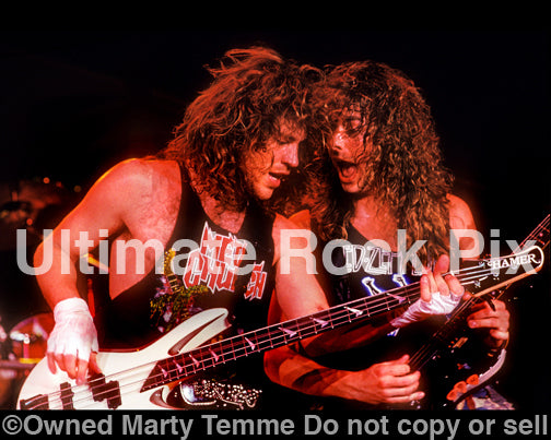 Photo of Kip Winger and Reb Beach in concert in 1989 by Marty Temme