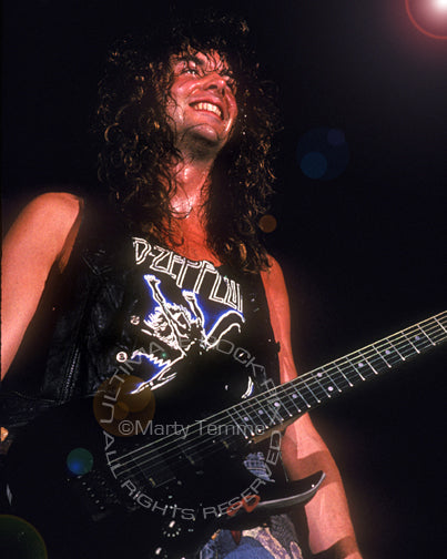 Photo of Reb Beach of Winger playing in concert in 1989 by Marty Temme