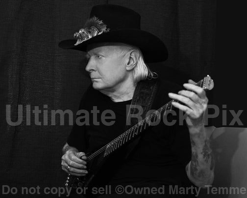 Black and white photo of Texas blues legend Johnny Winter during a photo shoot in 2013 by Marty Temme