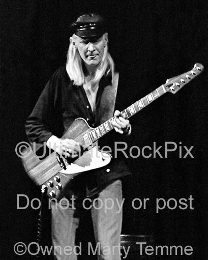 Photo of Johnny Winter playing his Firebird in concert in 1979 by Marty Temme
