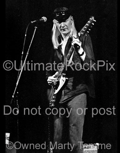 Black and white photos of Johnny Winter with his Gibson Firebird in concert in 1979 by Marty Temme