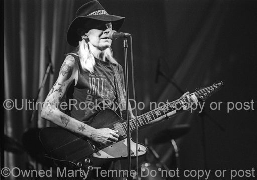 Photo of Johnny Winter playing his Gibson Firebird in concert in 1998 by Marty Temme