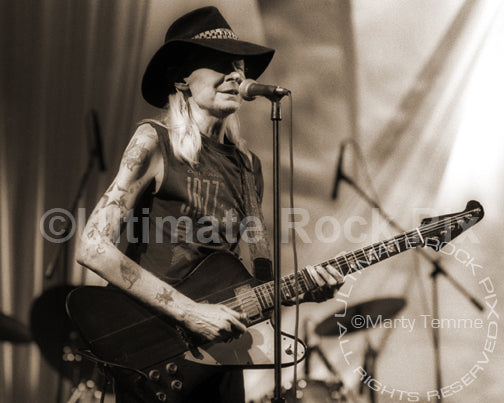Art Print of Johnny Winter playing his Gibson Firebird in concert in 1998 by Marty Temme